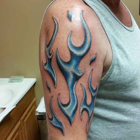 Blue flame tattoo on the arm