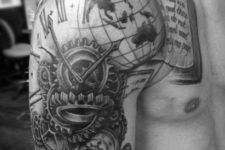 Book with globe, clock and compass tattoo on the shoulder and arm