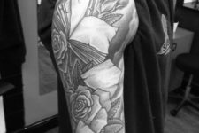 Book with roses tattoo on the arm