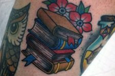 Books, flowers and owl tattoo