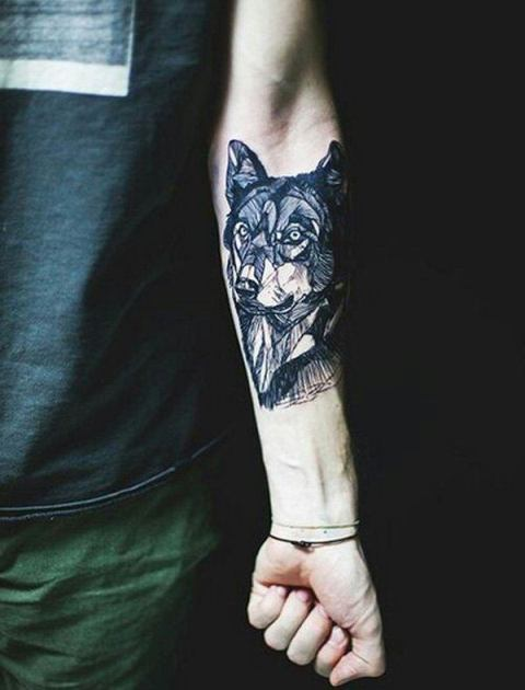 Calm wolf tattoo on the hand