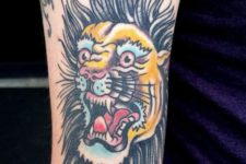 Cartoon lion tattoo