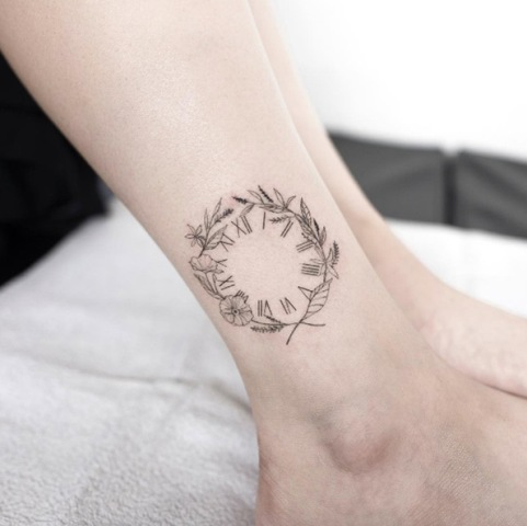 Clock tattoo on the ankle