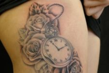 Clock with flowers tattoo on the leg