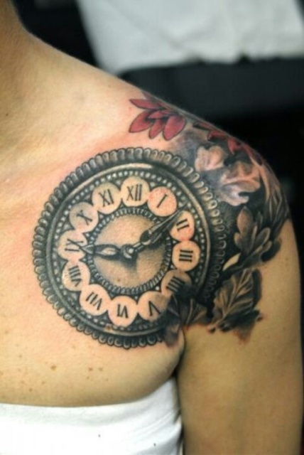 Clock with red flowers tattoo on the shoulder
