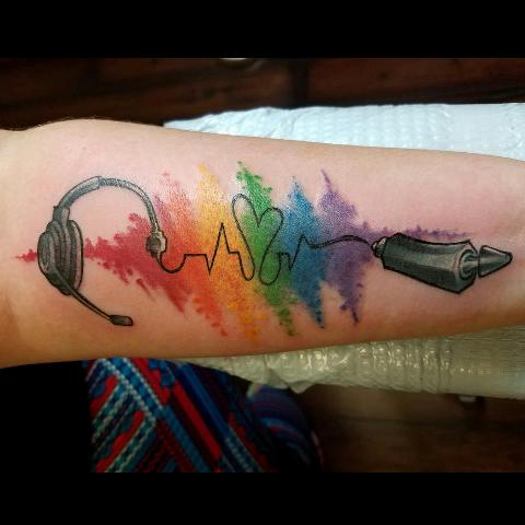 Colorful music tattoo on the hand
