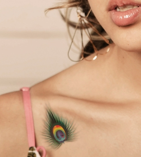 Colorful small tattoo on the shoulder