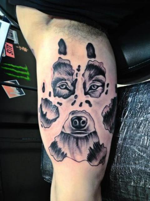 Cool bear tattoo on the arm