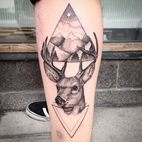 Deer and mountains tattoo