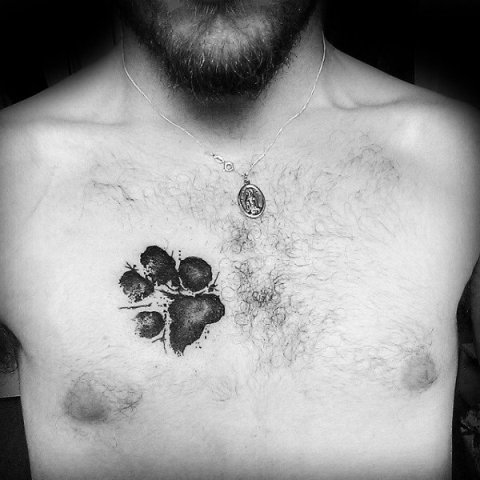 Dog paw tattoo on the chest