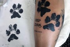 Dog paw tattoo on the leg