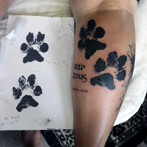 Dog paw tattoo on the leg