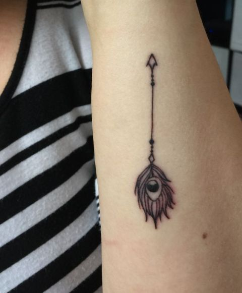 Feather with arrow tattoo