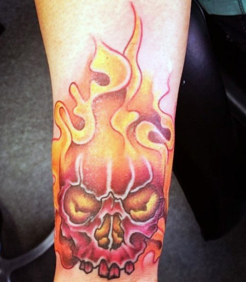 Flame and skull tattoo