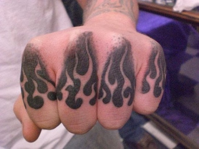 Flame tattoos on the fingers