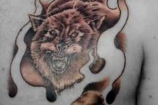 Flaming wolf tattoo on the chest