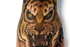 Formidable tiger face tattoo