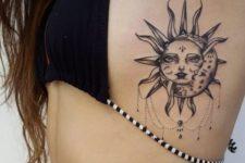 Gorgeous black sun and moon tattoo design