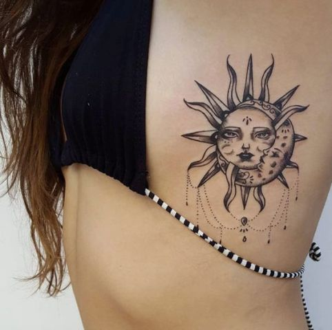 Gorgeous black sun and moon tattoo design