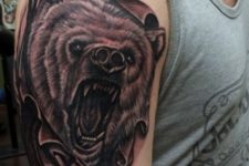 Half-sleeve bear tattoo