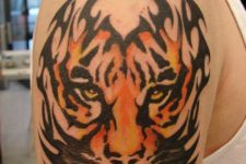 Half-sleeve tribal colored tiger tattoo