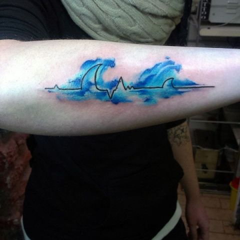 Heartbeat and blue waves tattoo