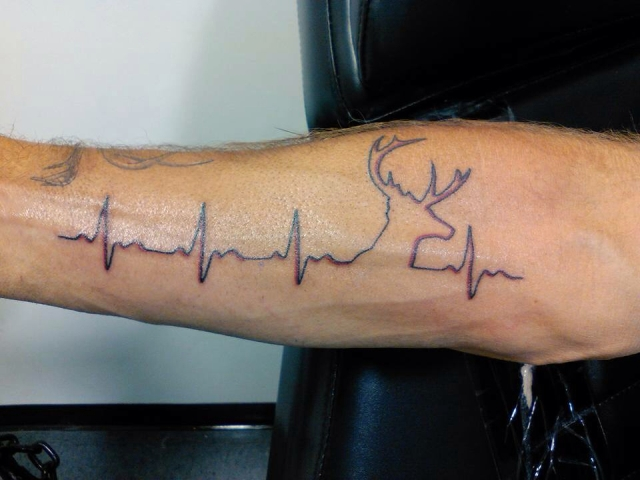 Heartbeat and deer tattoo