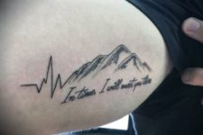 Heartbeat with black-contour mountain tattoo