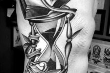 Hourglass and book tattoo on the side