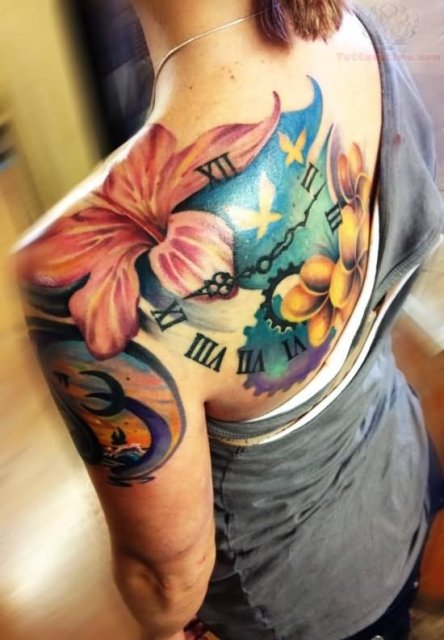Lily flower and clock tattoo on the back and shoulder