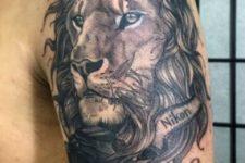 Lion with photo camera tattoo