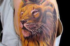 Lion with red and golden crown tattoo