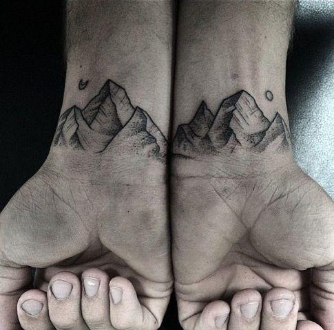 Mountain tattoos on the wrists