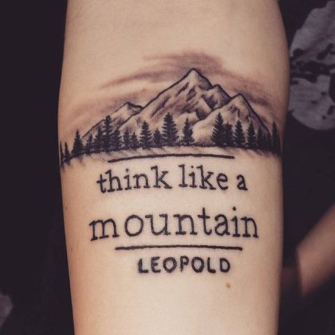 Mountain with forest tattoo