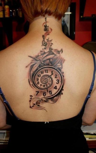 Music clock tattoo on the back