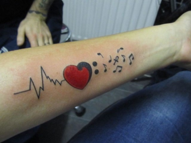 Music heartbeat tattoo on the arm