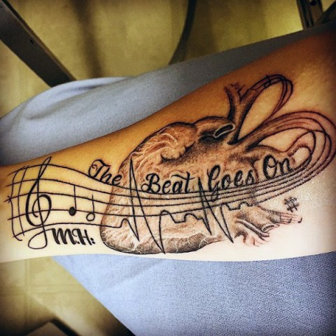 Musical and anatomical heartbeat tattoo