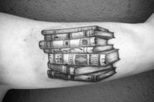 Old books tattoo on the arm