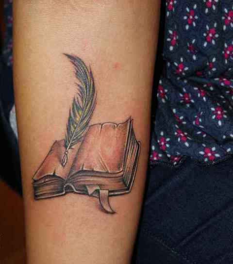 Open book tattoo on the arm