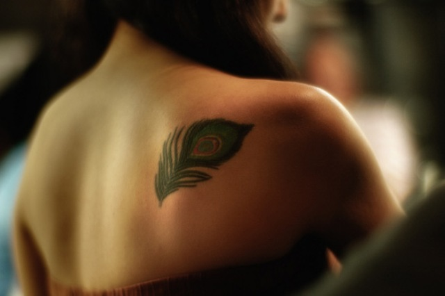 Peacock feather tattoo on the back