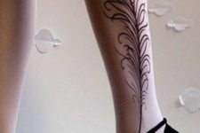 Peacock feather tattoo on the leg