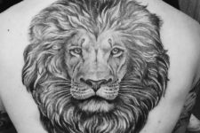 Perfect lion head tattoo on the back