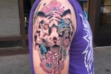 Pink and blue colored tiger tattoo