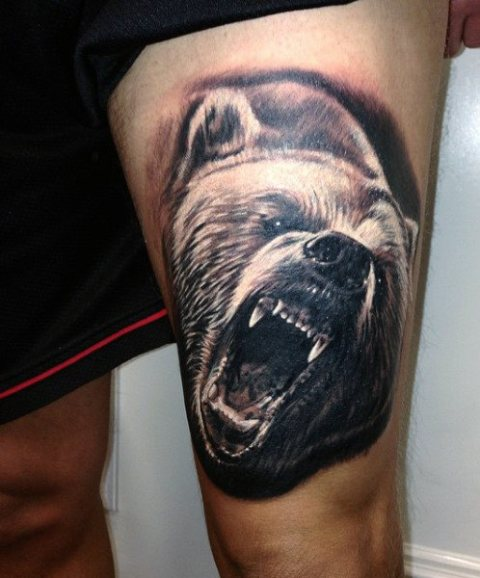 Realistic bear tattoo on the leg