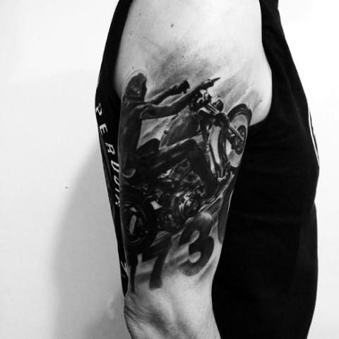 Shaded black tattoo on the arm