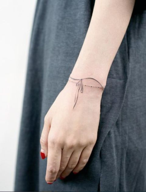 Simple and chic tattoo on the wrist