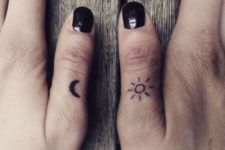 Simple sun and moon tattoos on the thumbs