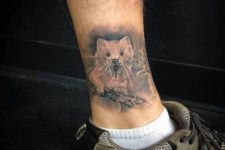 Small bear tattoo on the ankle