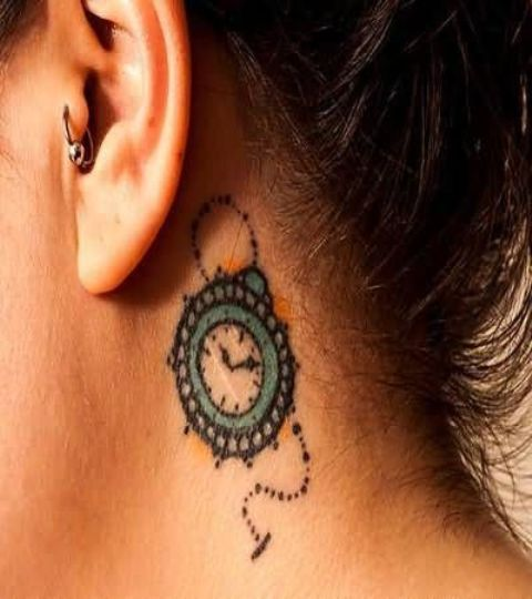 Small tattoo behind the ear