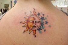 Sun and moon below neck tattoo